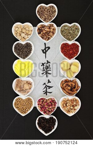 Traditional chinese herb tea selection with calligraphy on rice paper. Teas also used in natural alternative medicine. Translation reads as chinese herb tea.Translation reads as chinese herb tea.