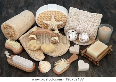 Natural spa and skincare beauty cleansing products with bathroom accessories including exfoliating scrubs, sponges, soaps and shells.