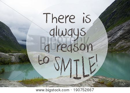 English Quote There Is Always A Reason To Smile. Lake With Mountains In Norway. Cloudy Sky. Peaceful Scenery, Landscape With Rocks And Grass. Greeting Card