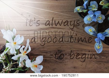 Wooden Background With English Quote It Is Always A Good Time To Begin. Sunny Spring Flowers Like Grape Hyacinth And Crocus. Aged Or Vintage Style