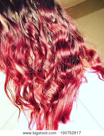 Dark brown to red ombre hair with curls