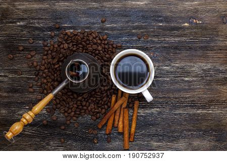 Beautiful coffee beans and fresh coffee on wooden table