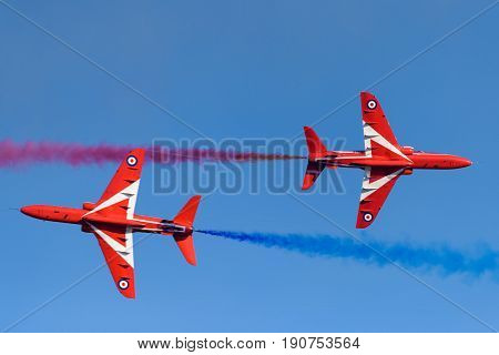 HELSINKI, FINLAND - JUNE 9, 2015: Red Arrows (The Royal Air Force Aerobatic Team) flying aerobatics at the Kaivopuisto Air Show June 9, 2017 in Helsinki, Finland.