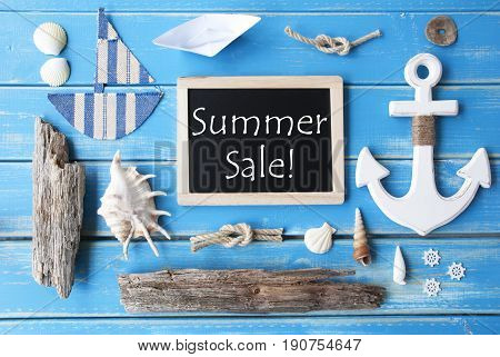 Flat Lay Of Chalkboard On Blue Wooden Background. Nautic Or Maritime Summer Decoration As Holiday Greeting Card. English Text Summer Sale