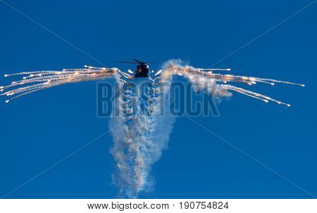 HELSINKI, FINLAND - JUNE 9, 2015: Finnish Army NH90 helicopter shooting out flares at the Kaivopuisto Air Show June 9, 2017 in Helsinki, Finland.