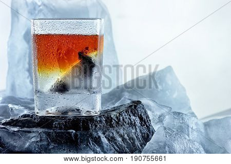 Glass Of Whiskey. On The Iceberg, Ice Everywhere.creative Photo Of Alcohol.advertisng Shot.copy Spac