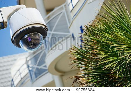 Security Cctv Camera Or Surveillance System With Modern Luxury Residence On Blurry Background