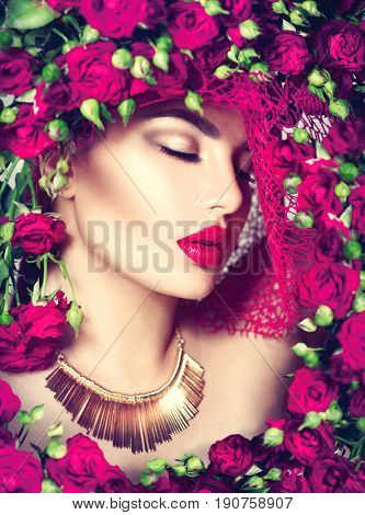Beauty model girl with pink roses flower wreath and fashion make up. Flowers Hair Style. Beautiful Lady with Blooming flowers on head. Nature Hairstyle. Holiday Fashion Makeup