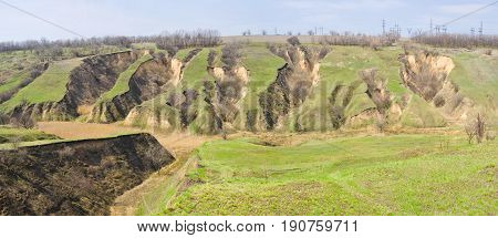 Panoramic picture of landscape with soil erosion in Ukraine.