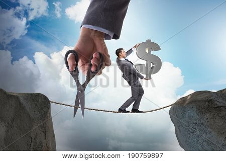 Man carrying dollar on tightrop