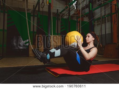Work out fitness woman doing sit ups exercises with medecine ball.