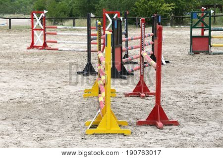 Old retro wooden barriers on the ground for jumping horses and riders