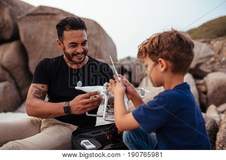 Father And Son Set Up Drone At The Beach