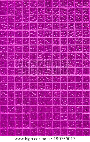 Pink tile wall of high resolution real photo or brick seamless and texture of interior background