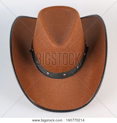 Brown cowboy hat isolated on white background