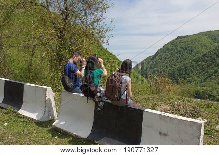 Active and healthy lifestyle on summer vacation and weekend tour. Tourists hitching a ride