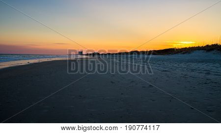 Sunset Beach In Myrtle Beach, South Carolina. Sunset on the shores of the wide sandy beaches of the Grand Strand in Myrtle Beach, South Carolina.