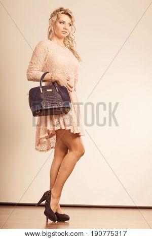 Woman With Beautiful Black Handbag.