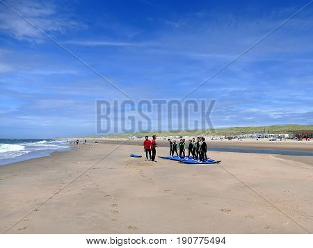 Castricum, The Netherlands - June 10, 2017: Young Teenagers Having Fun With Surfing Lessons Practisi
