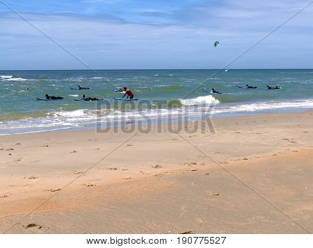 Castricum, The Netherlands - June 10, 2017: Young Teenagers Having Fun With Surfing Lessons