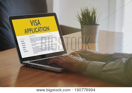 Man doing Visa Application by internet with a laptop.