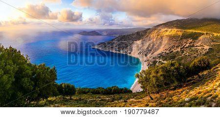 Breathtaking sunset over most beautiful beach Myrtos, Kefalonia