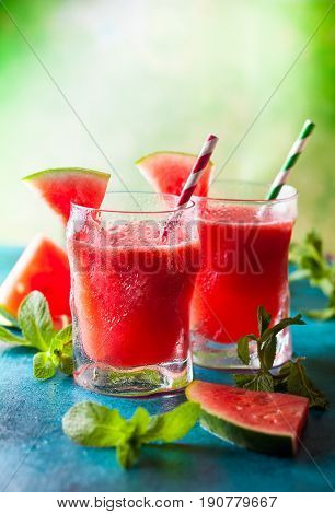 Summer refreshing watermelon drink in glasses with mint and drinking straw