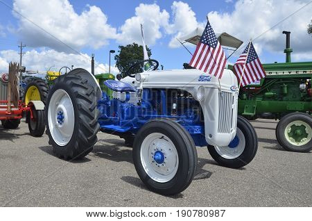 YANKTON, SOUTH DAKOTA, August 19, 2106: A Restored blue Ford tractor is displayed at the annual Riverboat Days celebrated the third weekend of August in Yankton, South Dakota.