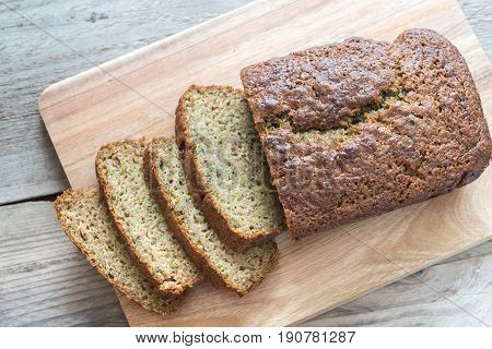 Zucchini bread on the wooden board close up