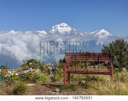 Lonely bench on Poon Hill - View to Dhaulaghiri from Poon Hill - Annapurna Circuit Trek in Nepal