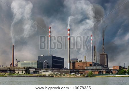 Air pollution and smog concept. Factory is producing toxic smoke.