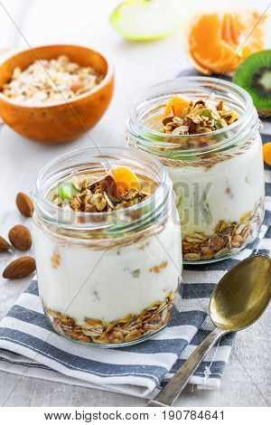 Delicious healthy American breakfast made of granola yogurt and fruits. Classic US morning meal. Traditional healthy snack.