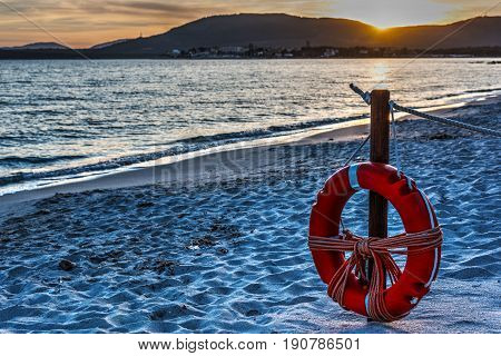 Life buoy by the sea at sunset. Sardinia Italy