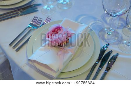 Spring table settings with fresh flower, napkin and silverware. Holidays background. Selective Focus