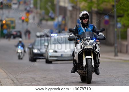 HELSINKI, FINLAND - MAY 25, 2015: The state funeral of the former President of the Republic of Finland Mauno Koivisto. President Sauli Niinistö arrives to the funeral service in a motorcade May 25, 2017 in Helsinki, Finland.