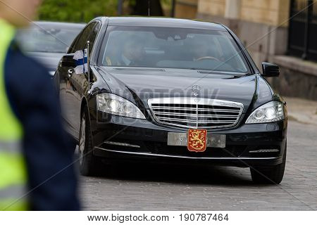 HELSINKI, FINLAND - MAY 25, 2015: The state funeral of the former President of Republic of Finland Mauno Koivisto. President Sauli Niinistö arrives to the funeral service in a motorcade May 25, 2017 in Helsinki, Finland.