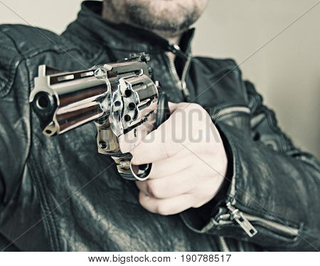 man with hand gun pistol rubber attack violence for your design