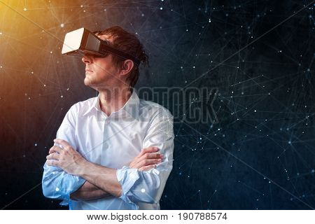 Businessman with VR goggles headset exploring virtual reality immersive technology content