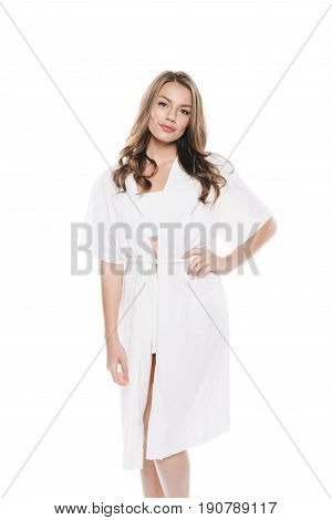 Portrait Of Beautiful Woman In Housecoat Standing With Hand On Hip And Looking At Camera Isolated On