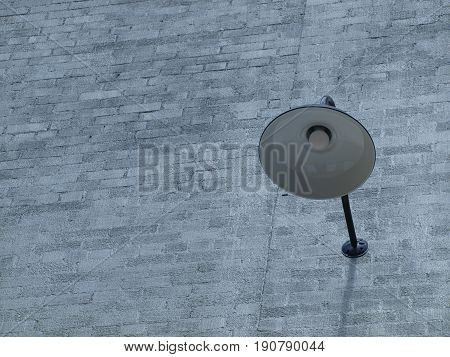 A period outdoor light fixture mounted onto a brick wall is making a hit to area restaurant goers.