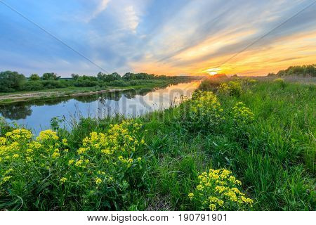 Sunset Above The River At Summer With Cloudy Sky Background.