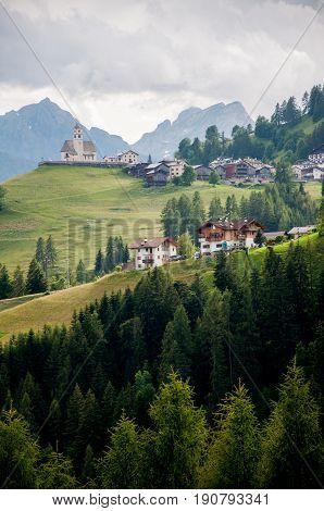 Italian Alps Dolomits late evening scene witch gospel on the hill.