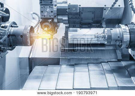 The CNC lathe machine or Turning machine drilling the metal rod with the drill tool and center drill tool .The hi-technology machining concept.