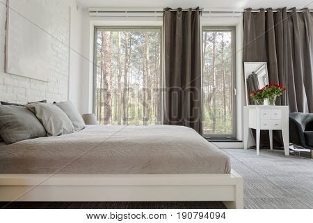 Comfortable king-size bed in a spacious bedroom with the patio entry