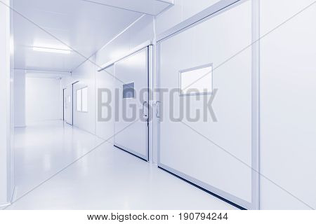 modern interior science laboratory or factory background with lighting in monotone
