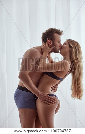 Passionate Couple Kissing And Embracing