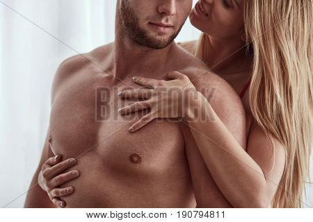 Woman Embracing Her Athletic Partner