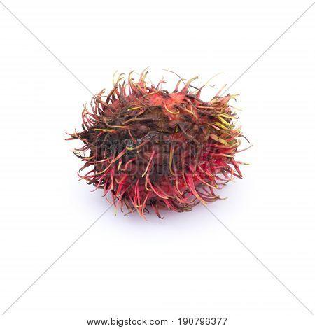 One rotten rambutan isolated on white background