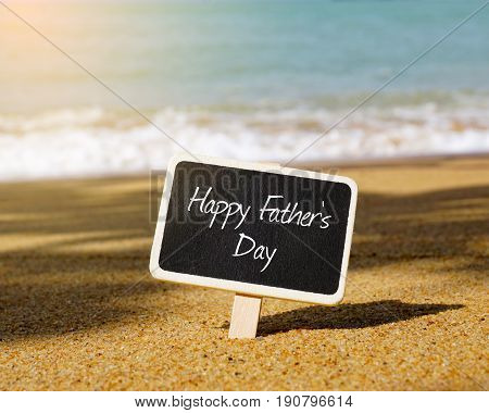 Happy Father's Day written on notebook and notes. Happy Father's Day concept.