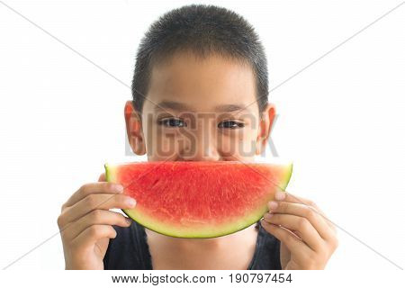Asian boy eating an watermelon isolated on white background